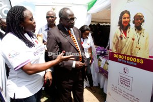 Dr Jacqueline Balungi (L) of Baylor - Uganda and the minister for General Duties Prof Tarsis Kabwegere launch the toll-free medical line during the Worlds Aids Day celebrations at Nyakasanga playgrounds in Kasese District yesterday.