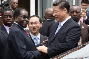 Chinese President Xi Jinping (R) with Zimbabwe President Robert Mugabe in Zimbabwe on Monday.